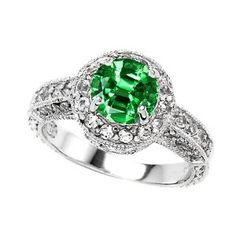 I acquired this band as a present from my boyfriend and its wonderful!  The band is very shiny and the emerald is a very pretty color. http://www.amazon.com/dp/B001JI1BH8/ref=nosim?tag=x8-20