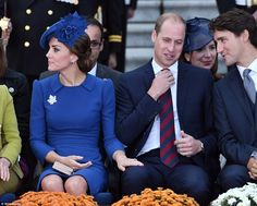 Kate laid a protective hand on William's thigh, as he exchanged pleasantries with Trudeau...