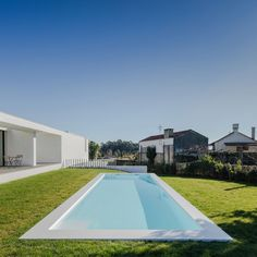 This modern construction, located in Touguinhó, Portugal, was designed by Raulino Silva in 2016. Built in the center of an immense plot of land, the home has beautiful gardens around it, and a swimming pool area where terraces provide a comfortable space to relax. The walls of the house adjoining the swimming pool area were made of glass so that, from the internal spaces, we can enjoy an abundance of..