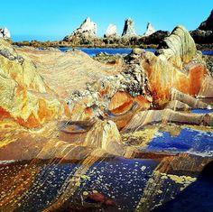 Playa de La Gueirua, Cudillero, Asturias, Spain. Waves are snorkeling in…
