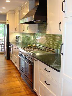 LOVE! White kitchen, cherry island, soapstone counters, hefty ORB hardware and that GREEN backsplash!