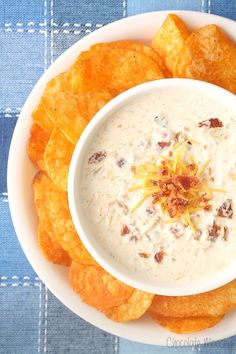 Ready to party? This Cheesy Bacon Ranch Dip is a sour cream dip amped up with lots of cheese and bacon, perfect for both potato chips and vegetables.