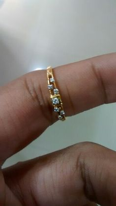 Nice..18 carat gold..ladies ring..with real diamond studed..beautiful design