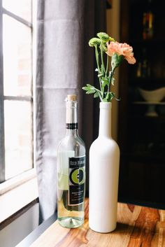 Spray paint old Ecco Domani bottles to use as a DIY vase!