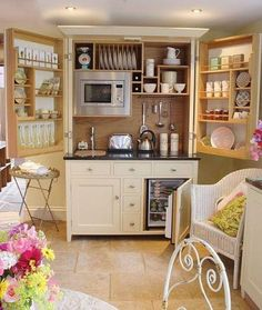 mini fridge IN a cabinet so you don't see it.  higher storage shelving so the coffee pot fits.