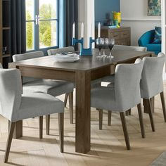 Dark oak dining table with upholstered chairs with a dark oak frame. #home #homedecor #interiordecor #interiordesign #interior123 #furniture #wood