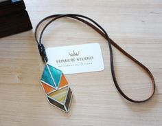 Ethnic stained glass necklace on leather cord, Tiffany teqnique, glass pendant by LumiereStudio on Etsy https://www.etsy.com/listing/238872041/ethnic-stained-glass-necklace-on-leather
