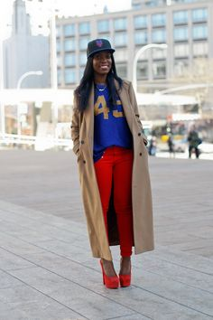 Super Bowl Style - How to Make a Sports Jersey Look Chic - ankle length camel coat + a jersey, red skinny jeans, matching platform heels and a cap