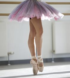 Pointe shoes with elastics and you can just see the toe pads