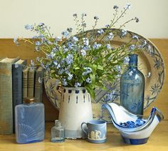 Lovely blue and white pieces help make an impressive table setting.