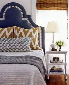 Color palate for great room: gray walls, navy couch, gold accents