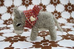 In my fantasy crafting world, I will make this adorable needle felted donkey with a muffler. Or I can just buy it on etsy for $17!