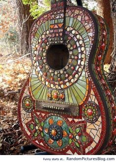 The definition of bohemian is Gypsy or wanderer. A person, musician, artist or writer that lives a free spirited life. The colors used in the mosaic on the guitar ( olive, turquoise and copper) are favored colors when your going for a bohemian look. Mosaic Glass, Mosaic Tiles, Stained Glass, Glass Art, Mosaics, Glass Tiles, Gaudi Mosaic, Tiling, Mundo Hippie