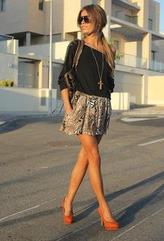 Summer style... black off-the-shoulder tee, printed skirt, tan shoes, long necklace.
