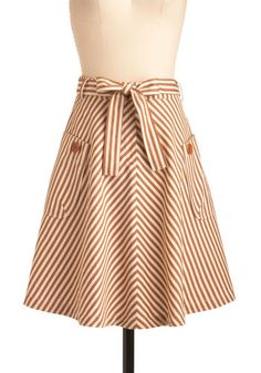 Cute bias-cut striped skirt, love the color and the buttoned pockets