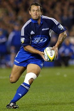 """CARLOS SPENCER was unchallenged as the Blues' most enthralling entertainer with his skill at first five-eighths, becoming universally known as """"King Carlos."""" He will be remembered for the outrageous way he taunted Crusaders' fans, when in 2004 at Christchurch he deliberately ran to the corner rather than the posts to score, but still landed the conversion from the sideline to deny the hosts even a bonus point."""