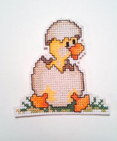 """Brand new handmade cross stitch Christmas or Easter ornament decoration. Baby duckling hatching. Stitched on 14 count white Aida with cotton thread in beige, brown, yellow, orange, black and green. Backed in oatmeal colored felt. Total piece measures 3""""w ..."""