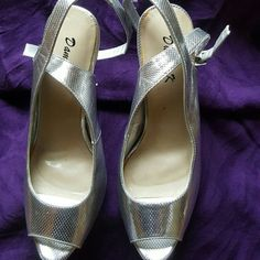 All silver platform heels. Silver embossed platform heels, with silver heel. Great condition, worn only once. Damask k Shoes Heels