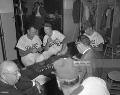 Brooklyn Dodgers manager Walt Alston playing cards with his coaches in the clubhouse before the last game played by the Dodgers at Ebbets Field in Brooklyn, New York on September 24, 1957. The Dodgers would defeat the Pittsburgh Pirates by a score of 2-0.