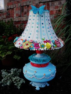 I created this lamp re-do today as a gift for my baby girl's birthday! Be sure and stop by my blog if you want to see what the lamp looked like before I transformed it! blog - www.justaboutthedetails.com - gift, up-cycle, diy, lamp, lamp shade, craft, buttons, flowers, spray paint, acrylic paint, birthday present, girly gift