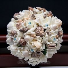 Maker Irena C.K. handcrafts the perfect bridal bouquets for a beach wedding.  Have your own designed at: www.custommade.com #beachwedding #shell #custommade
