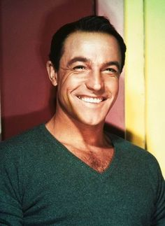 Gene Kelly - fell in love with him when I was some 12 years old and still find him darn attractive.