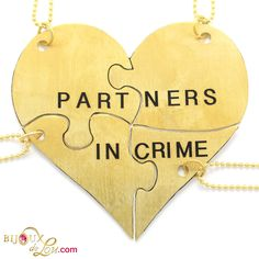 Brass Partners in Crime 4-Piece Necklace Set: Made of lasercut brass with a golden color, the heart is 3 inches at the widest point when assembled. It breaks into 4 puzzle piece pendants, each with its own matching 24 inch long brass necklace chain. Limited quantities available. Also sold in a stainless steel version.