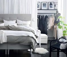 Really like the idea of the closet rack behind a sheet on the bedside wall. Ikea you're a bunch of smartypantses
