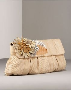Google Image Result for http://designerbagcatalog.com/wp-content/uploads/2009/10/carlos-falchi-floral-applique-phyton-designer-clutch-evening-bag.jpg