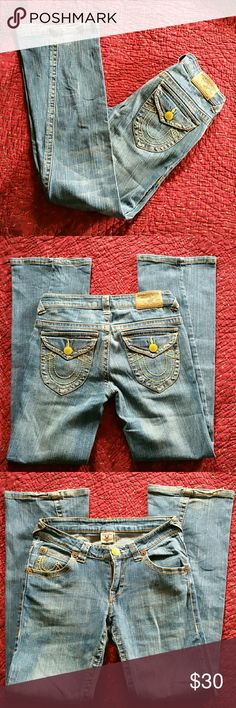 """True Religion Jeans This is a great pair of denim for Spring & Summer! They have a lil bit of stretch, are lightweight, and have a lighter wash- almost a """"dirty"""" washed look. They're in great condition for pre-loved jeans, but the bottom hems are a bit destroyed from being too long/stepped on lol. Yellow stitching. They're a size 29 with a 31"""" inseam. True Religion Jeans Flare & Wide Leg"""