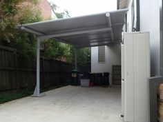 Cantilevered carport awning, with poles only one side (Outrigger Awnings and Sails)