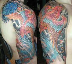 Colorful Phoenix With Flowers Tattoo On Man Right Half Sleeve