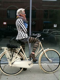 Silver hair, cream bike, well paired neutrals.