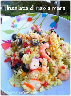 """Un'insalata di riso un po' diversa da quella classica, migliore direi, con l'aggiunta di qualche """"pescetto"""" ad impreziosire questo tipi..."""
