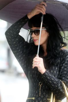 Katy Perry Photos Photos - Katy Perry seems to enjoy a massive Los Angeles rain storm while going for lunch at Fred 62 in Los Feliz. Katy was wearing a very short dress, with black stockings and a gold purse. - Katy Perry in Los Feliz 2