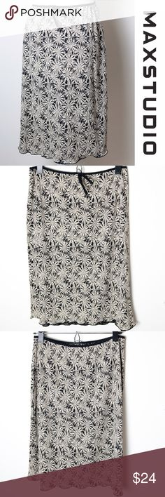 """Max Studio Tan Black Floral Skirt Medium Size medium tan and black floral skirt from Max Studio. Light weight and perfect for summer. Elastic waistband with a decorative tie in the front. Features a graphic floral pattern. 100% polyester, machine wash warm, tumble dry low, use cool iron. Approximate measurements - 27"""" waist, 23"""" long Max Studio Skirts"""