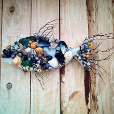 Seashell,seafan and seaglass wall hanging fish. #driftwood #driftwoodart #driftwoodartist #fish#seaglass #shells #ocean #waves #surf #coast #coastal #coastalliving #coastallife #coastaldecor #recycled #rustic #washedup #interiordesign #poole #seafan#driftaway #seashore #seaside #sea #beachcomber #beach #beachdecor #beachhousedecor