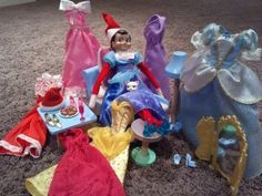 Elf on the Shelf Elf decided to try on Barbies clothing