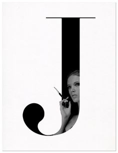 "how the image/photo is framed within the typeface, yet the hand and cigarette bleed out  but does not lose the visual aspect of the letter ""J"" ....  typography photography"