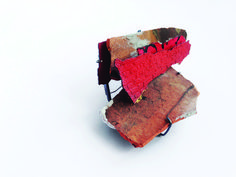 Han-Chieh Chuang  Red Brick Brooch no.19 - 2014 - bricks, enamel, copper, silver, paper, cement, gold foil, steel wira
