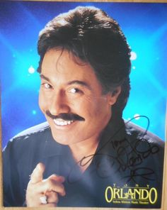 """This is A Tony Orlando Signed Autographed 8"""" X 10 """" Color Photo with A Horizontal Center Crease. Tony Orlando The Tony Orlando Yellow Ribbon Music Theatre in Branson, Missouri was opened in 1993. 