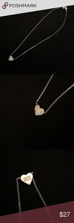 NWOT Michael Kors silver heart necklace NWOT Silver rhinestone studded heart necklace with MK engraving on the back Michael Kors Jewelry Necklaces
