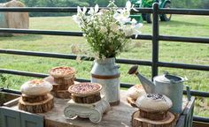 Pie Dessert Table  An assortment of tarts and pies rested on charming pedestals made from stacked logs to compliment this ranch-themed wedding.