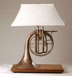 Made this lamp for my music room a few years ago. Used French horn from local … Made this lamp for my music room a few years ago. Used French horn from local antique store, old walnut plank and a shade from an old lamp that I had. Made the base to mirro