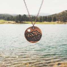 The mountains are one of my favorite places to be. This adorable pendant, hangs from an 18in copper chain. It measures 1in in diameter.    Made from