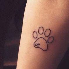 dog tattoo on arm