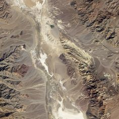 The Badwater Basin region of California's Death Valley acquired by NASA's Earth Observing-1 satellite (EO-1) on October 23, 2002. Alluvial fans in the image are remarkably similar to the terrain that the Curiosity rover will explore on Mars. Image and annotations from NASA Earth Observatory