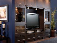 Combinación de almacenaje para TV BESTÅ negro-marrón con cajones, puertas paneladas y puertas de vidrio