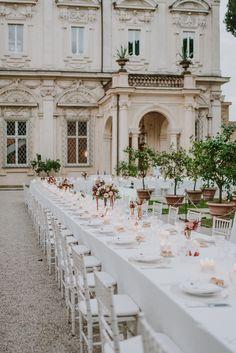 Al fresco Roma villa wedding table decor: Photography: Gianluca And Mary Adovasio - www.gianlucaadovasio.it/   Read More on SMP: http://www.stylemepretty.com/destination-weddings/italy-weddings/2017/03/07/a-fashion-designer-weds-at-villa-aurelia-in-rome/