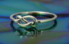 This sterling silver infinity knot ring is great to wear every day. It is 16 gauge handmade especially for you when you order. Also known as a nautical knot ring, love knot, celtic knot or stop knot. Infinity Knot Ring, Celtic Knot Ring, Celtic Rings, Celtic Wedding Rings, Etsy Jewelry, Jewelry Accessories, Jewellery, Making Ideas, Silver Rings